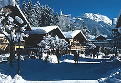 The Palace Hotel overlooks the car free village of Gstaad along alpine mountain peaks
